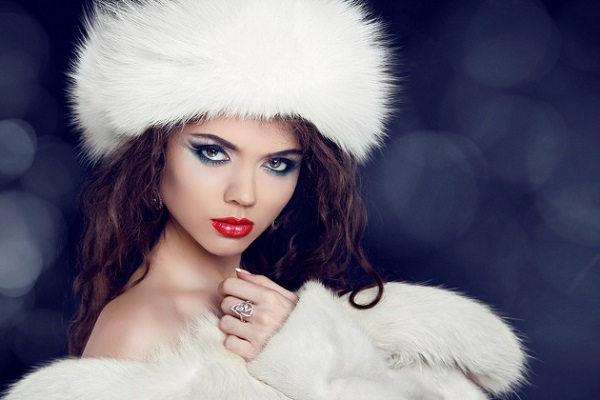 Winter woman in fur coat. Glamour portrait of beautiful woman model